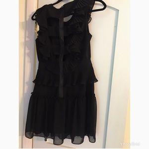 Beautiful multi dimensional BCBG black dress.
